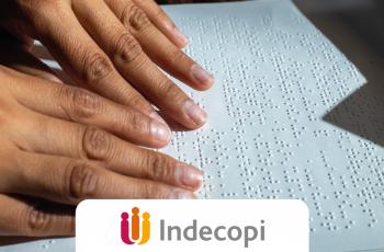 manos leyendo braille