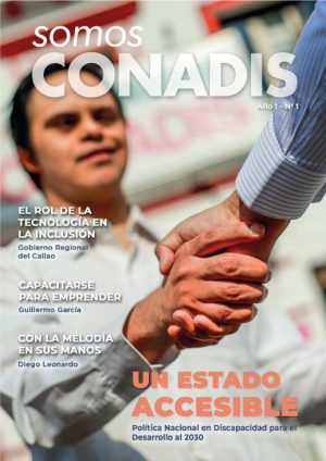 revista de primera edición de la revista con la imagen de un joven con discapacidad estrechando la mano a un funcionario del conadis en señal de compromiso