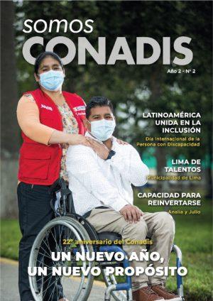 portada de la segunda edición de la revista con la foto de una servidora de conadis tocando el hombro de un joven con discapacidad en silla de ruedas en señal de apoyo y acompañamiento